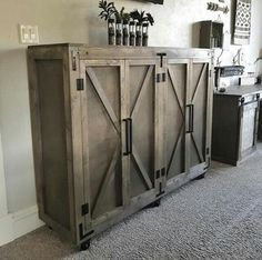What a neat bar cabinet. I need this!!