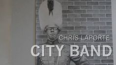 """Chris LaPorte is a Grand Rapids, Michigan based artist who loves to draw. He is currently creating a life size pencil drawing called """"City Band"""" for submission…"""