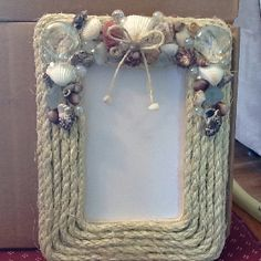Made this beach decor picture frame.