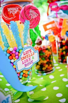 Candy (readily available in all colors of the rainbow) makes guests smile when presented buffet style!