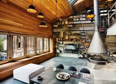 We love this modern loft interior design with wood and creative industrial elements. The loft, a stunning project designed by Ofist, was created specifically for a bachelor client. Cabinet D Architecture, Interior Architecture, Moderne Lofts, Loft Design, House Design, Loft Stil, Style Loft, Micro Apartment, Rustic Contemporary