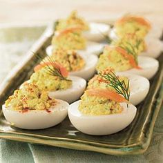 Hard-cooked eggs get dolled up with the classic combination of smoked salmon and cream cheese. If you're buying smoked salmon for a special occasion, set aside some for this hors d'oeuvre.