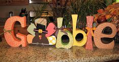 Decorate some wood letters to make great holiday decor. I love how the O is a turkey! Read more at the photo link. Thanksgiving Wood Crafts, Thanksgiving Decorations, Fall Crafts, Holiday Crafts, Holiday Fun, Fall Decorations, Pallet Thanksgiving Ideas, Holiday Ideas, Family Thanksgiving