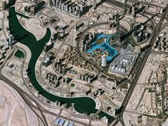 Desert Oasis  Image courtesy ESA    A man-made lake in the desert city of Dubai in the United Arab Emirates appears bright blue in a satellite image taken January 4 and released October 10 by the European Space Agency. The lake sits next to the Burj Khalifa skyscraper, the tallest building in the world.