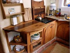 Love the use of material in this tiny kitchen.