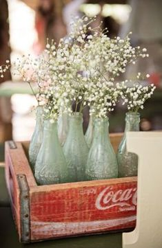 love the old Coke bottles with baby's breath! Photo by Melissa Lauren Images http://melissalaurenimages.com/
