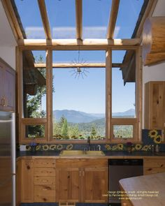 Kitchen window in a log post and beam home I designed In British Columbia built…