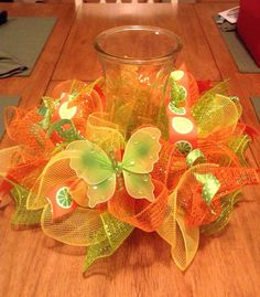 Items similar to Table centerpiece/ summer mesh centerpiece/ mesh candle holder/ vase holder on Etsy Deco Mesh Crafts, Wreath Crafts, Diy Crafts, Summer Deco, Summer Centerpieces, Candle Centerpieces, Owl Wreaths, Deco Mesh Wreaths, Summer Wreath