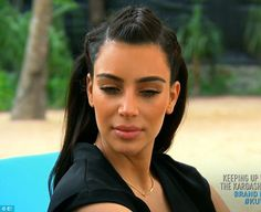 Bronzed: Kim went heavy on the bronzer and eyebrow pencil for her day by the pool...
