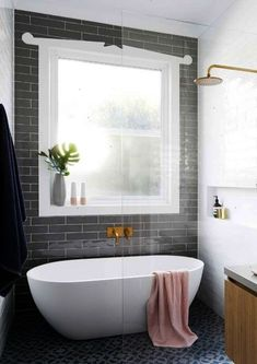 Love the giant window and tile but would prefer drop in tub.   The new classic bathroom