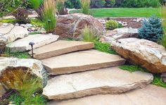Twisting stone stairs and large boulders in Rustic Outdoor Living in Arvada Mile High Landscaping in Denver