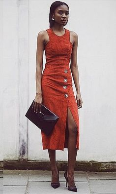 A sophisticated suede dress and a luxe clutch