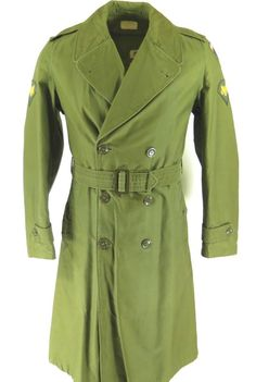 <p>This OG-107 sateen overcoat has a QM (quarter master) number dating it to 1959. It also has official patches on both shoulders for a soldier of the specialist rank. The rainbow sword patch indicates that they were stationed in Europe. This is a truly rare find because of the hard to find small long size and it comes complete with the removable liner.</p>