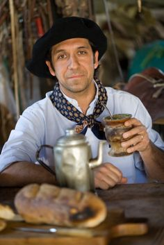 A gaucho drinking his invigorating mate.  It does have caffeine  will give you a lift.  (: