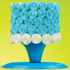 Impress family and friends with a cake covered in wonderful ribbon roses! Pipe the ribbon roses in advance using royal icing and Wilton Decorating Tip 12 for the bases and Decorating Tip 104 for the petals.