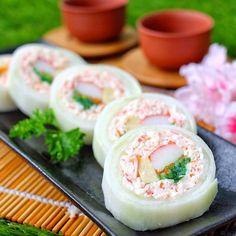 Snow Crab Narudo Roll! Crab stick, seaweed, egg, tobikko circled with Japanese cucumber.