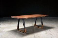 The Griswold Dining Table  Solid American Walnut Top 2 thick. Extremely durable matte conversion varnish. Blacked steel base with walnut insert.