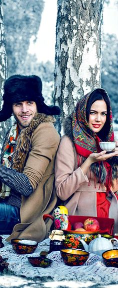 Russian beauty. Russian girls. Fashion. Folk. Winter tea time. Snow. Tradition floral scarf and fur hat.