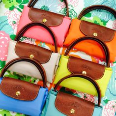 Longchamp Spring 2014 Le Pliage. I'll take one of each color please!