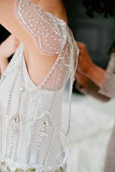 Delicate beading on the bride's Jenny Packham dress. Photography: Isabelle Selby Photography - isabelleselbyphotography.com Read More: http://www.stylemepretty.com/2014/08/20/spring-park-wedding-in-nyc/