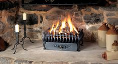 A fire basket with straight front in a choice of Matt black or highlight polished cast iron. The Spanish fire basket is available for burning wood, coal an Open Fires, Gas Fires, Cottage Dining Rooms, Living Room Decor, Flueless Gas Stove, Faux Fireplace, Fireplaces, Fire Basket, Log Burner