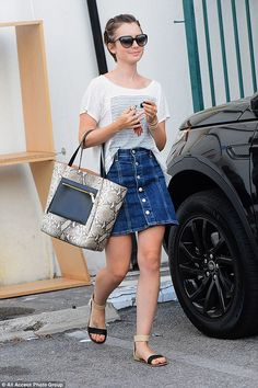 Off duty chic! Lily Collins cut a casual figure as she stepped out in Beverly Hills on Tue...