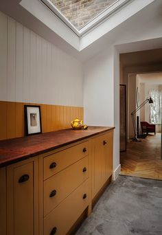 Two toned color scheme using India Yellow by Farrow and Ball with British Standard Cupboards, Toni Halliday, Rachel Aspland | Remodelista