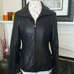 NWOT Black Leather Jacket Jones NY Black Genuine Leather Jacket.  Form fitting once zipped up and gives a feminine silhouette look. Only worn once! Jones New York Jackets & Coats
