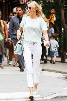 Karolina Kurkova spent the sunny summer afternoon walking through New York's Tribeca neighborhood on June 26th in a soft, fresh look. Kurkova stuck to two colors - cool mint and white - for her jeans, tee, Coach Legacy bag, and sneakers. Kurkova also managed to grab a trendy pair of clear sunnies for the walk.