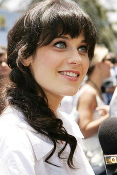 A woman, a goddess, a sorceress...    Zooey Deschanel