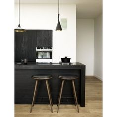 Love this minimalist kitchen with the wood waterfall island counter and Tom Dixon drum lights. mater Bar Height Stool - Dark Stained Hardwood.