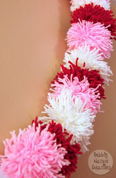 Pom Pom Garland (or scarf). Cute for Valentine's Day or a little girl's bedroom/nursery. The kiddies could help with this project... fun. Good tutuorial.