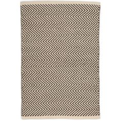 The thickest of our indoor/outdoor PET rugs, this contrasting ivory and charcoal zigzag pattern offers subtle geometric interest on a durable, easy-care floor covering for the porch, patio, kitchen, or hallway.Made of 100% PET, a polyester fiber made from recycled plastic bottles.