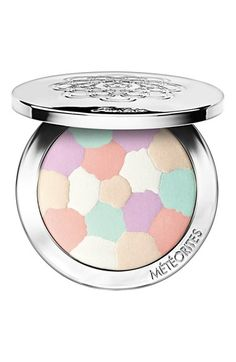 Guerlain 'Météorites' Compactat -- Guerlain has transformed its legendary Météorites Pearls into a compact. The pearls are finely pressed to form a beautiful mosaic of light-enhancing and corrective shades that create a subtle and natural effect by giving your skin tone just the right amount of light and correction.