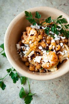 Healthy, flavorful Moroccan-inspired recipe for roasted cauliflower salad, with harissa and roasted chickpeas.