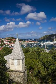 Photographic Print: French West Indies, St-Barthelemy. Gustavia, Anglican Church and elevated view towards Gustavia Har by Walter Bibikow : 36x24in