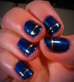 Blue nail polish with gold stripe