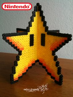From Super Mario Bros. : Invincibility Star Here is the Model to make the Invicibility Star Remember to leave half of a line of beads open, but look closely : each star have a different half li. Hama Beads Design, Hama Beads Patterns, Beading Patterns, Hama Beads Mario, 3d Perler Bead, Hamma Beads 3d, Fuse Beads, Pixel Art, Nerd Crafts