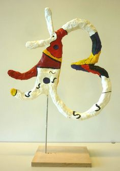 Miro paintings inspire these figures. Kids bend wire into Miro-like forms, wrap them with old newspapers, glue strips and plaster. Finally they paint the figures in Miro's manner.