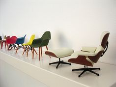 Collection of miniature Eames chairs.