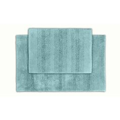 Classic and comfortable, the Westport Stripe bath collection adds instant luxury to your bathroom, shower room or spa. Machine-washable, the aqua blue plush nylon holds up to wear, while the non-skid latex makes sure the rug stays in place.