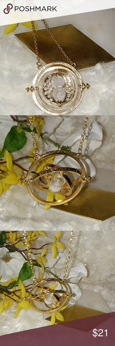 Harry Potter Time Turner Necklace This is a true Love or List item! Purchased but never worn this is the gold Time Turner Necklace replicated from the movie Harry Potter as worn by Hermoine. It has the rotating parts and hour glass with sand in it. I know you will love it, that's why I'm listing it! Jewelry Necklaces