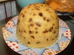 Spotted Dick or Spotted Dog - a raisin studded, steamed pudding Brit style - very yummy with real English pouring custard - recipe link.