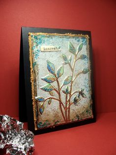 """By Audrie (girlgeek101 at Splitcoaststampers. Focal image: Glue """"Fresh Foliage"""" (Memory Box) die-cut to chipboard. Wrap piece with aluminum foil. Brayer to flatten; use stylus to impress foil around die-cut. Color with alcohol inks and copic makers."""