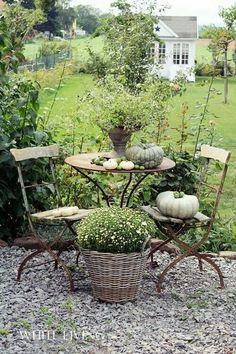 I would love this little bistro table setting just outside my potting shed. #shabby chic #bistro table