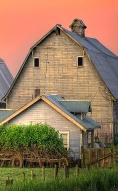 I seriouslydon't know about pink skies overhead, but I love the colors on the barn. Nice pic!
