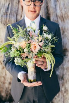 So many things to LOVE about this #Bouquet! See more on SMP - http://www.stylemepretty.com/washington-weddings/2014/01/09/coastal-glam-pacific-northwest-inspiration-shoot/ Love Song Photo | Paisley Petals