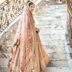 Pastels and peaches are an understated color in Indian weddings. This bride sure knows her colors. But they can be beautiful like @abujanisandeepkhosla 's show last night told us. Haven't seen it yet ? Check out our stories to catch all the peaks !  .  .  @shadesphotographyindia.  .  .  #weddingzin #wedding #weddingphoto #weddingplanner #weddingdress #wedding #weddinggoals #weddinginspo #weddingphotography  #indianbride #instalike #instalove #instawedding