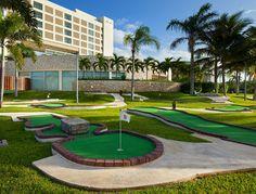 Enjoy casual recreation beneath shading palm trees at the resort's inviting 18-hole miniature golf course - The Westin Lagunamar Ocean Resort Villas & Spa #svnlife #cancun