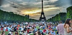 Snack on Brie and a baguette on the Champs de Mars (the lawn surrounding the Eiffel Tower)